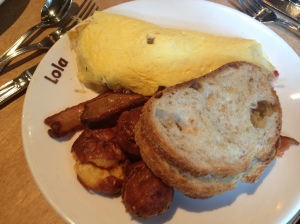 Lola's Omelette florina peppers summer squash, sweete onion,goat cheese, smashed garlic fried potatoes, bacon, toast